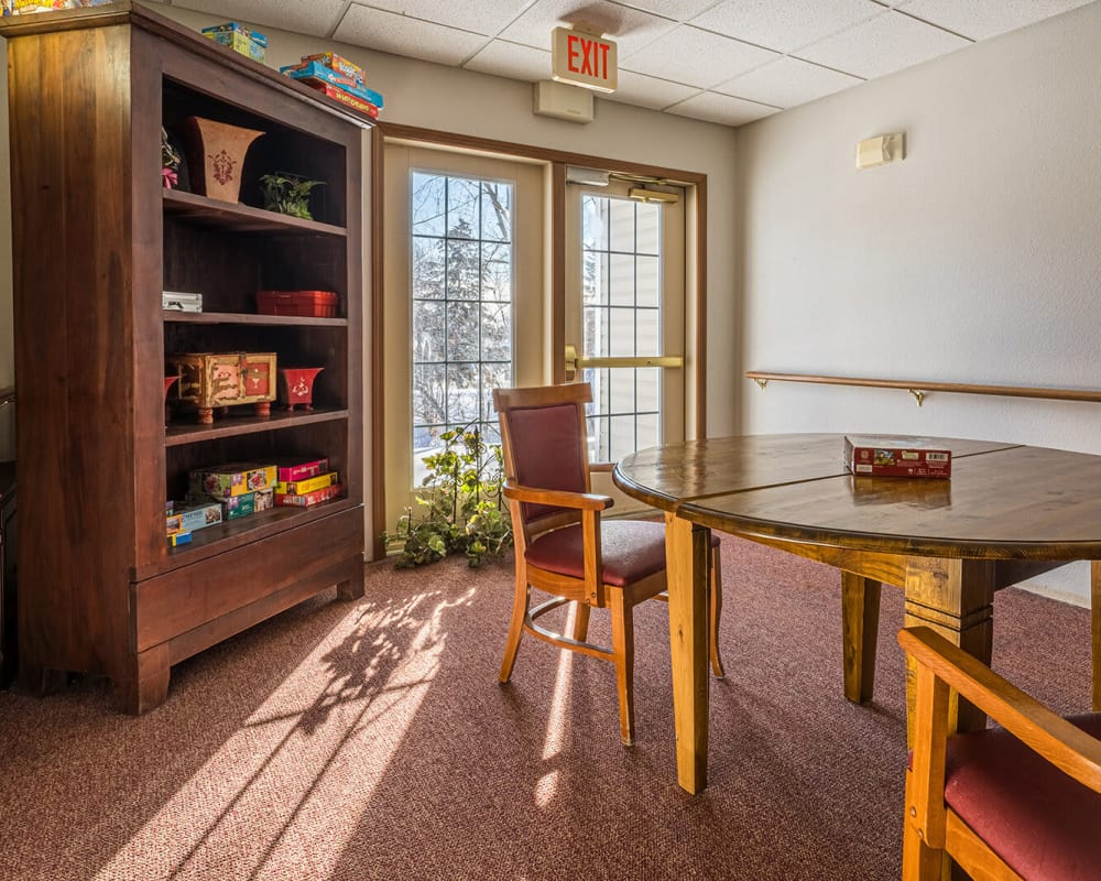 Sunlit game room at Traditions of Owatonna in Owatonna, Minnesota.