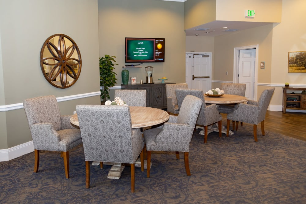 Sitting room with tables at The Legacy at Liberty Ridge in West Chester, Ohio