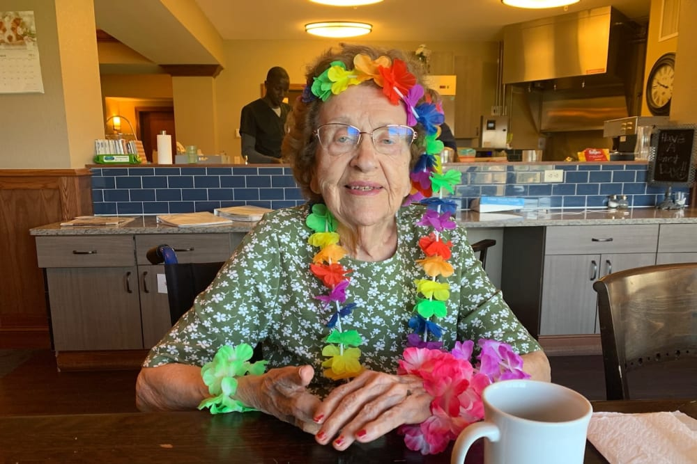 A resident with a Hawaiian lei on at Water's Edge in Mankato, Minnesota