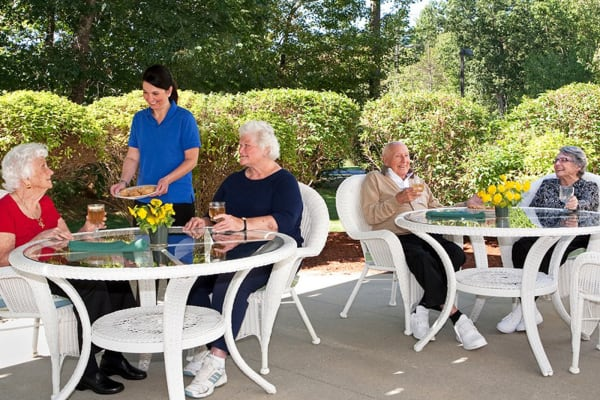 Residents dining outside at Woodstock Terrace in Woodstock, Vermont