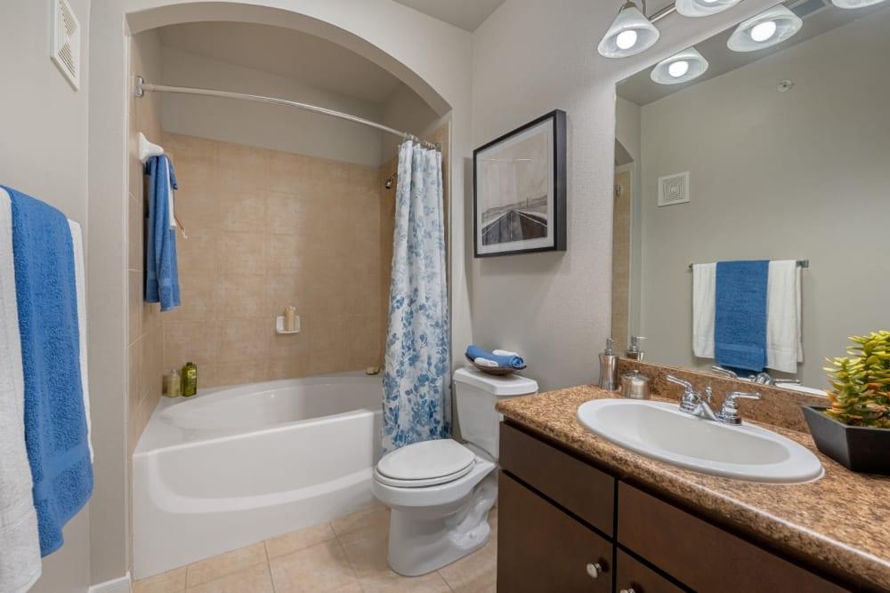Bright bathroom with full size bathtub at Marquis at Sugar Land in Sugar Land, Texas