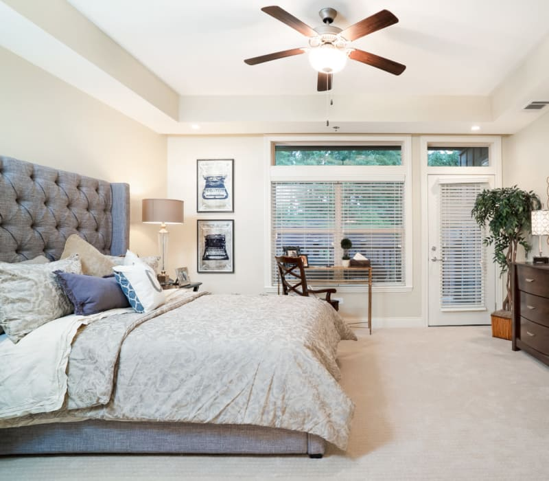A cozy resident bedroom at Celebration Village in Suwanee, Georgia