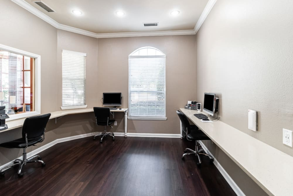 Executive business center with multiple workstations at Marquis of Carmel Valley in Charlotte, North Carolina
