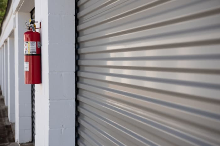 Roll up door and fire extinguisher at  Space Shop Self Storage in Covington, GA