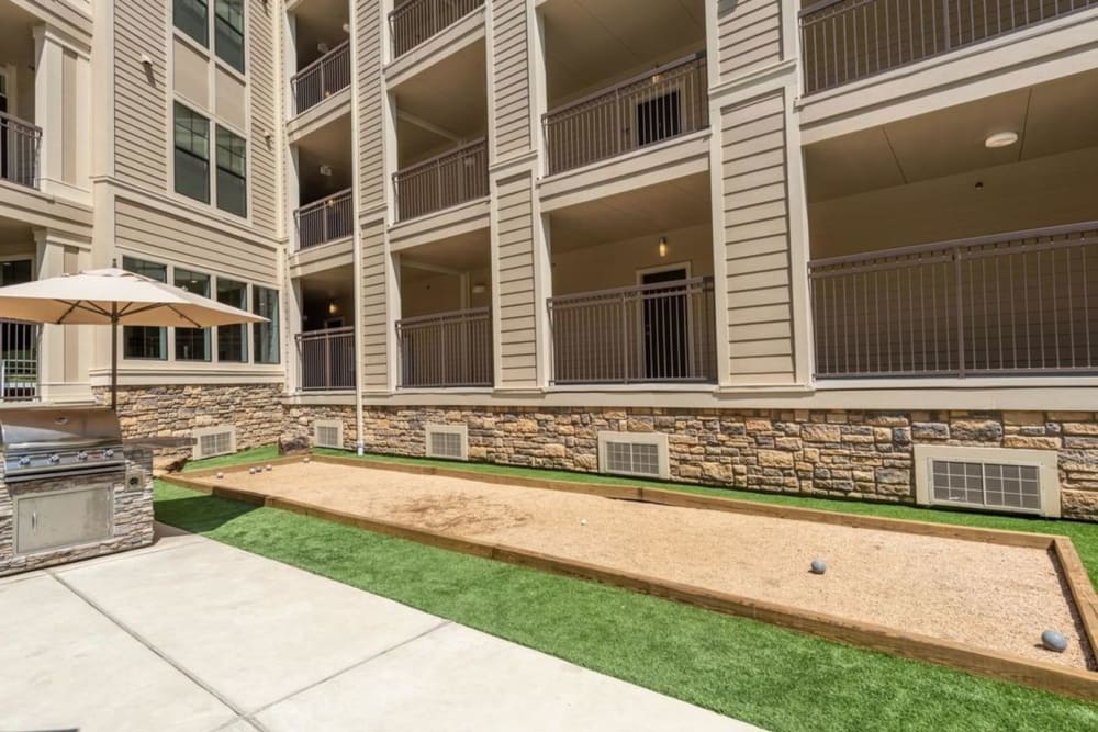 Bocce court and grill in the courtyard of Heights West 11th in Houston, Texas