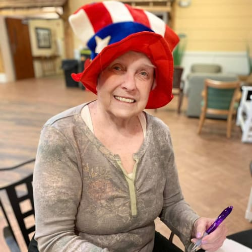 Resident playing bingo at Oxford Glen Memory Care at Owasso in Owasso, Oklahoma