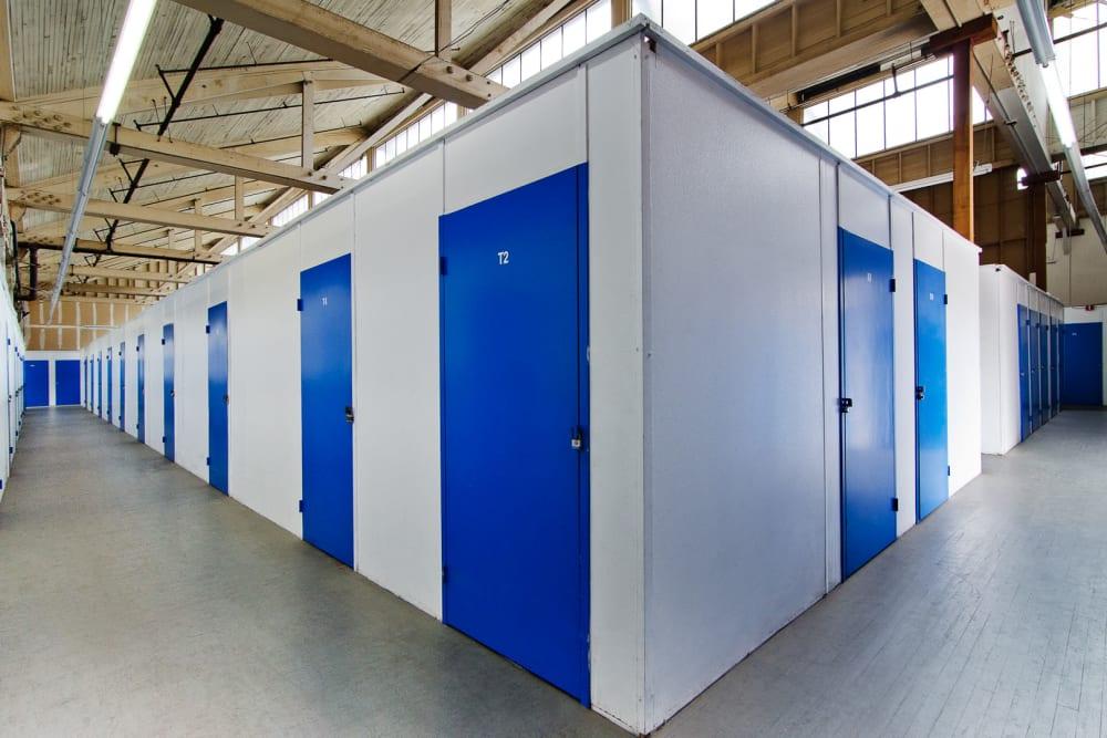 Indoor storage units with blue doors at A-American Self Storage in Santa Barbara, California
