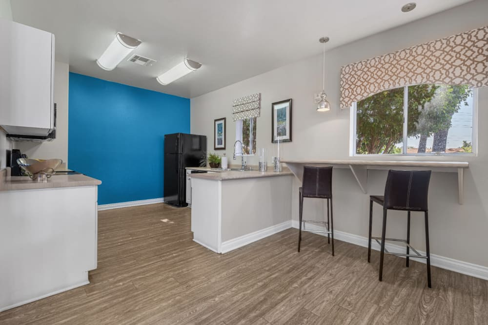 Community kitchen with bar stools at Alante at the Islands in Chandler, Arizona