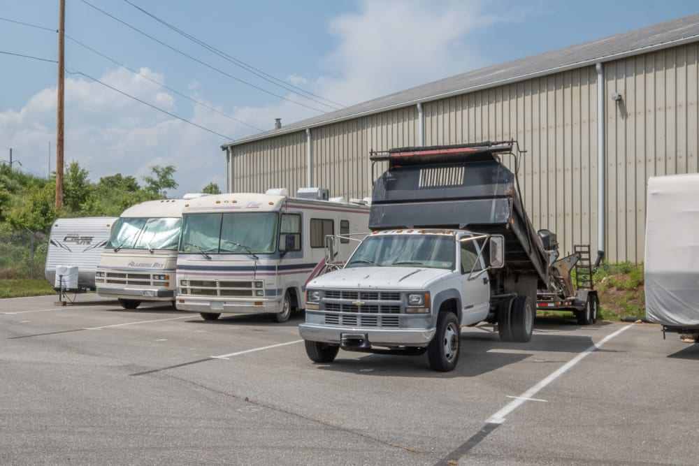 RVs and a flatbed truck stored at Apperson Self Storage 2 in Roanoke, Virginia