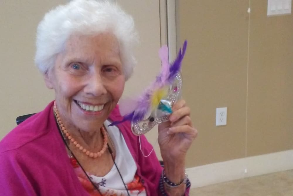 Resident making arts and crafts at Merrill Gardens at Huntington Beach in Huntington Beach, California.