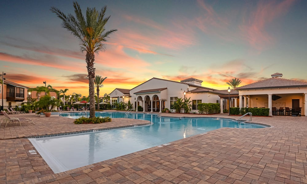 Colorful sky above the swimming pool at dusk at Hacienda Club in Jacksonville, Florida