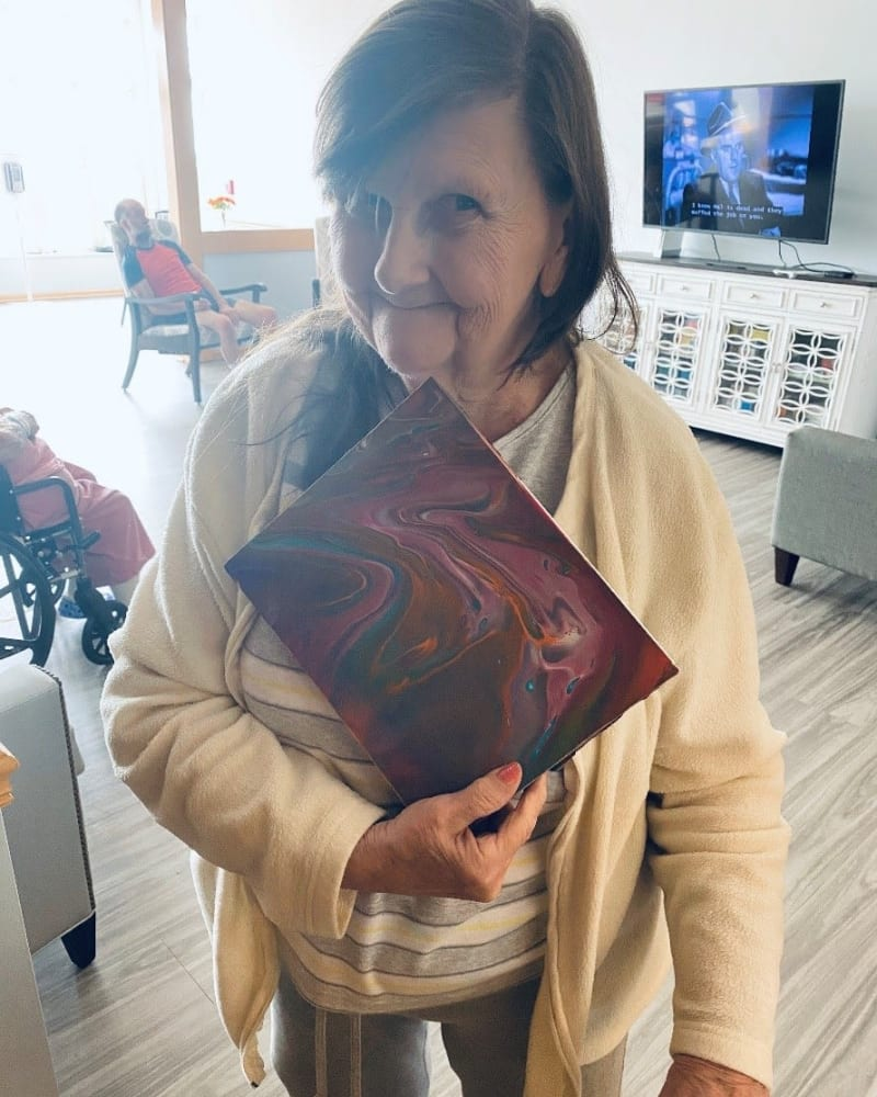 Resident and her artwork at Apple Creek Place in Appleton, Wisconsin
