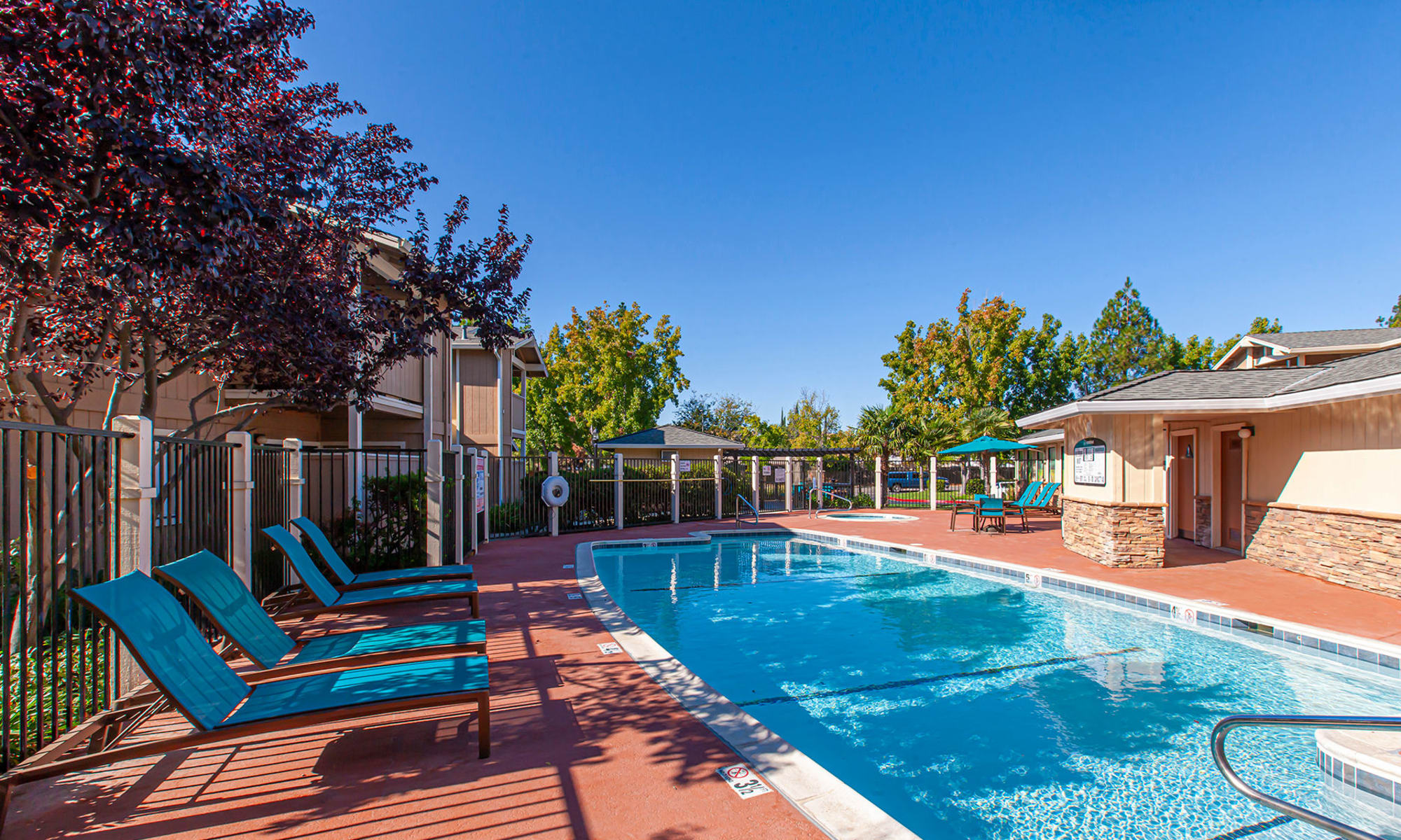 Sparkling Pool area with lounge chairs  in Vacaville, CA