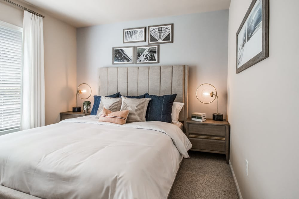Bright and cheerful bedroom with carpet at Marquis at Carmel Commons in Charlotte, North Carolina