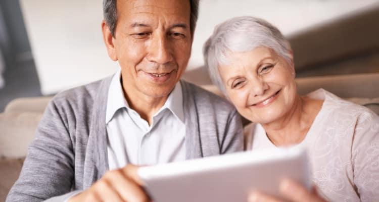 Senior and caregiver holding tablet at Maplewood at Chardon in Chardon, Ohio