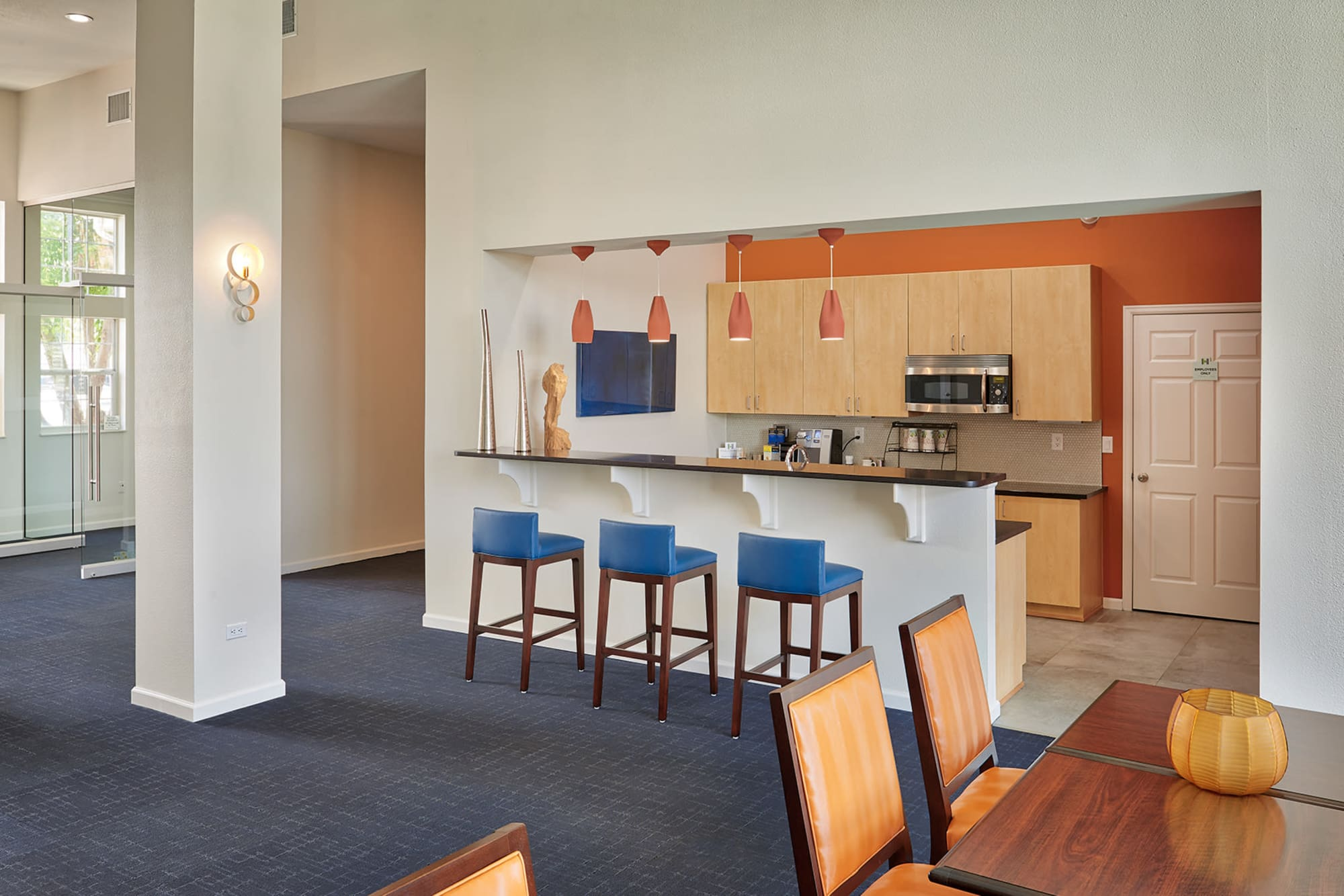 Clubhouse kitchen with bar seating at Villas at Homestead Apartments in Englewood, Colorado
