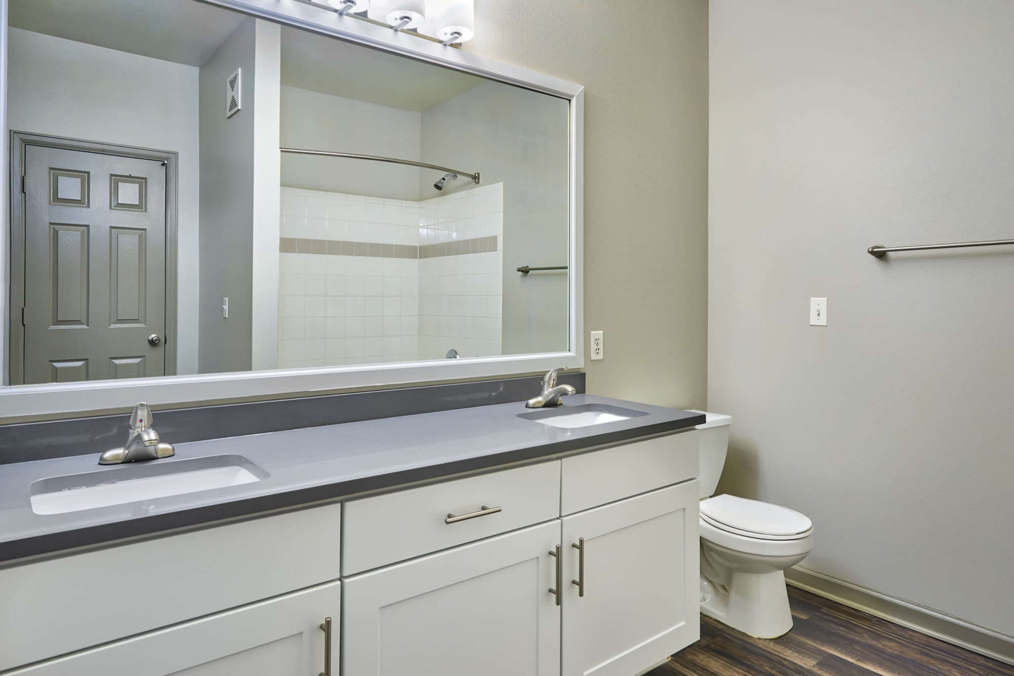 bathroom at Gateway Park Apartments in Denver, CO with white cabinetry renovation