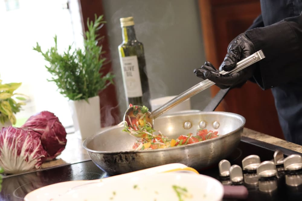 Chef prepares delicious meal at The Springs at Carman Oaks in Lake Oswego, Oregon