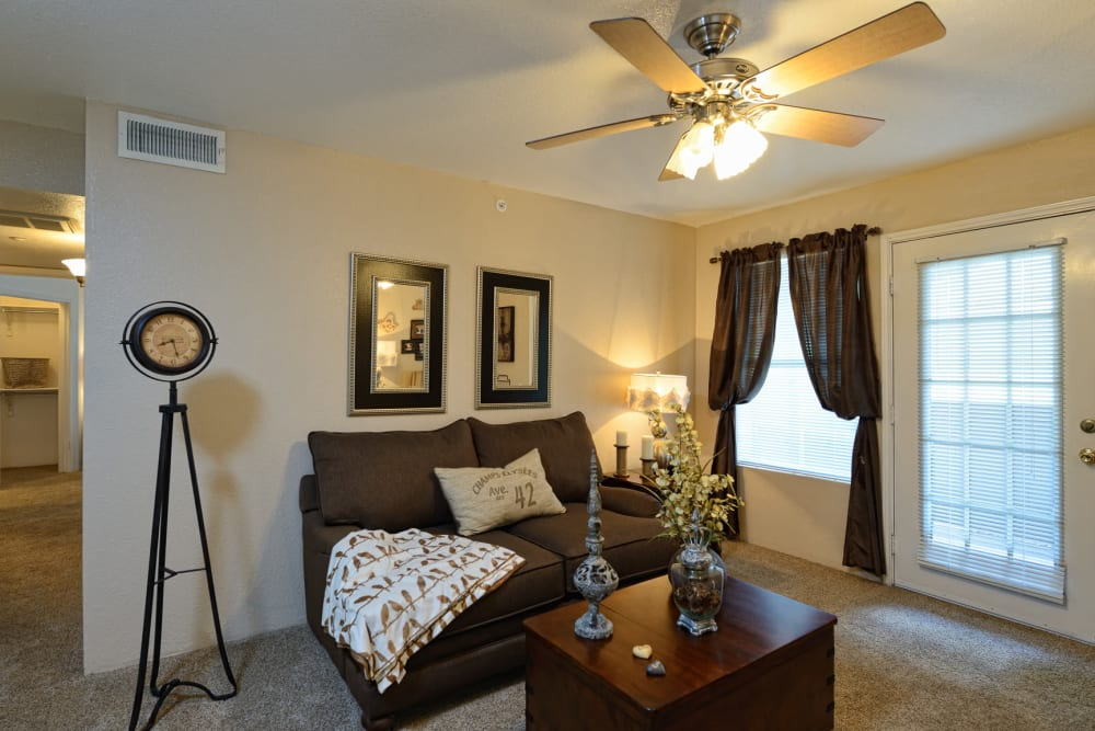 Bright living room at Acacia Park Apartments in El Paso, Texas