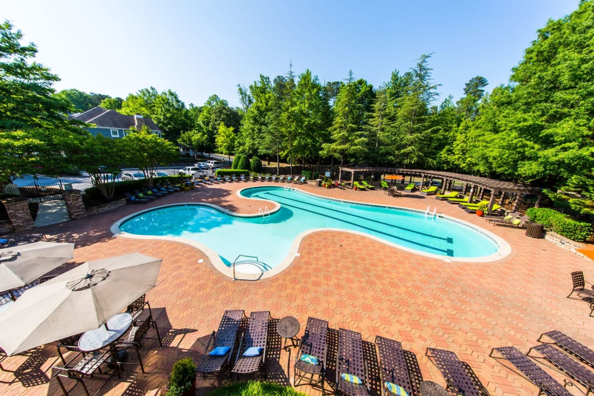 Sparkling pool with sun chairs at Marquis on Edwards Mill in Raleigh, North Carolina