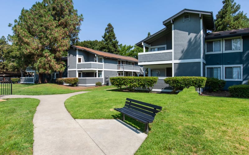 Exterior of the building and beautiful landscaping at Avery Park Apartments in Fairfield, California