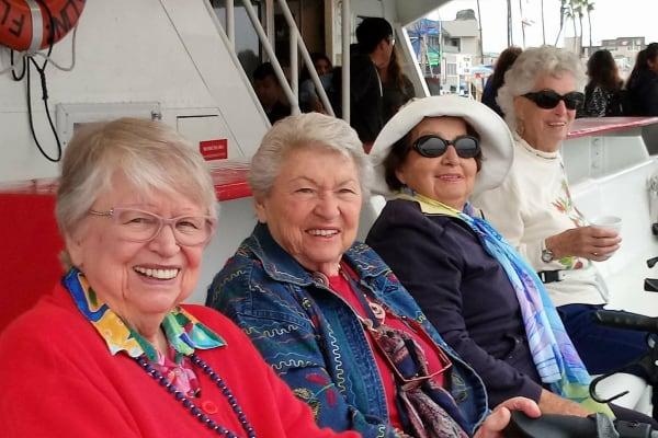 Resident friends on an outing near Merrill Gardens at Huntington Beach in Huntington Beach, California.