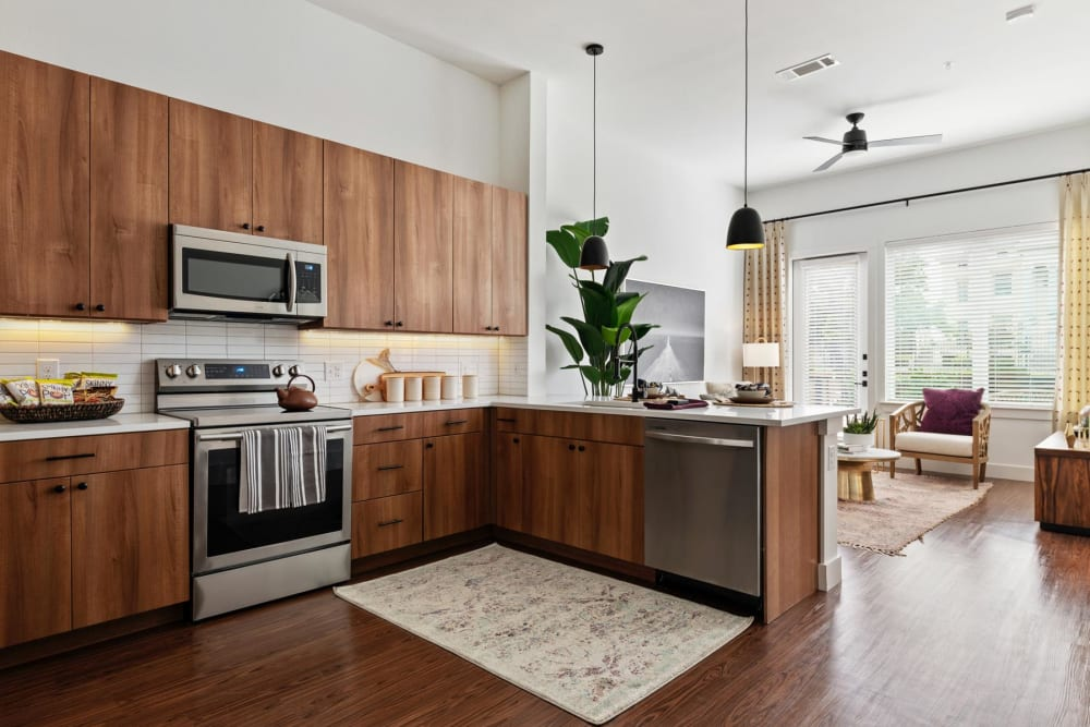 Beautifully crafted custom wood cabinetry and stainless-steel appliances in a model home's kitchen at 4600 Ross in Dallas, Texas