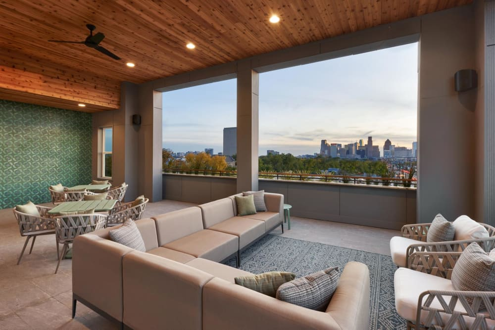Open-air lounge with beautiful city views on the top floor at 4600 Ross in Dallas, Texas
