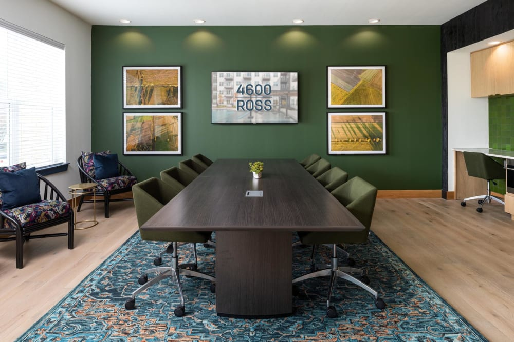 Meeting room with a large conference table in the business center at 4600 Ross in Dallas, Texas