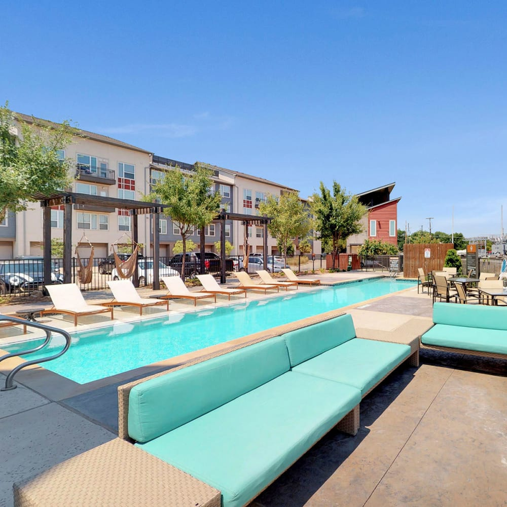 Lounge seating area near the pool on another gorgeous day at Oaks Trinity in Dallas, Texas