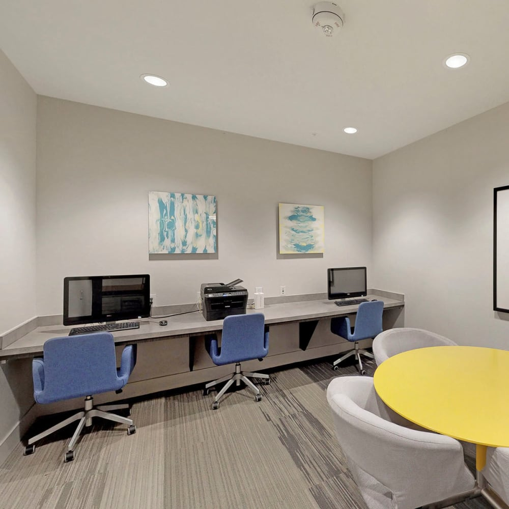 Business center with workstations for resident use at Oaks Trinity in Dallas, Texas