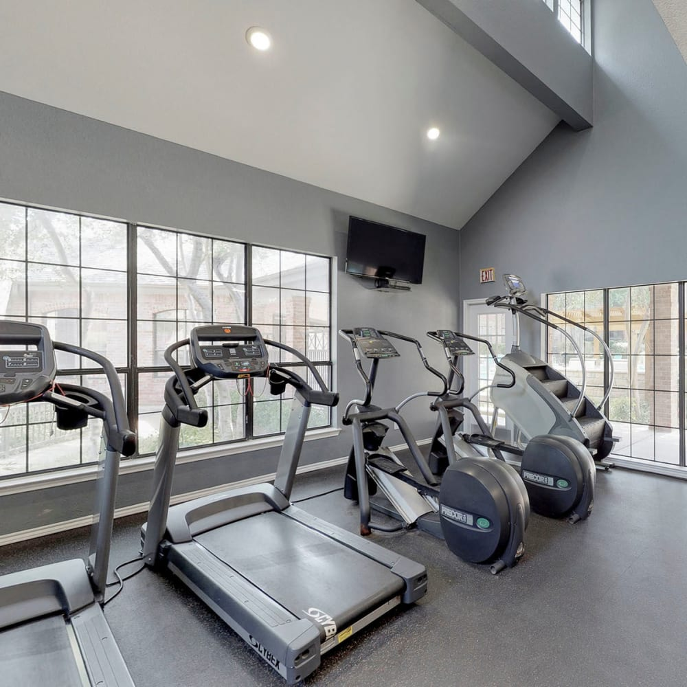 Treadmills and cardio equipment in the fitness center at Oaks Hackberry Creek in Las Colinas, Texas