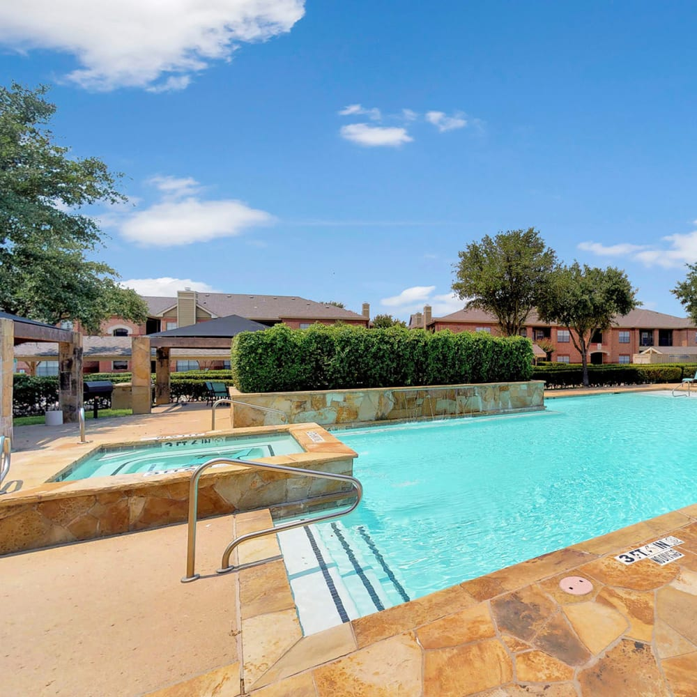 Spa overlooking the pool at Oaks Riverchase in Coppell, Texas