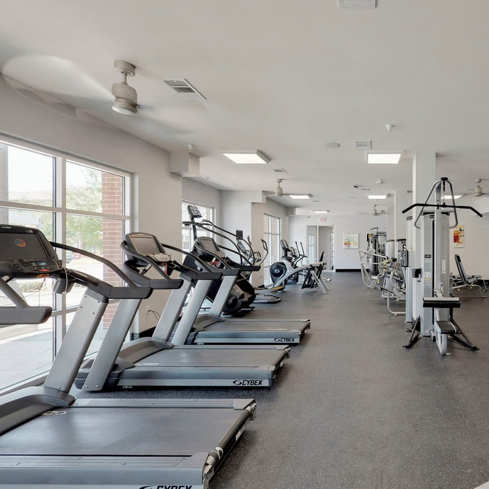 Treadmills and more in the fitness center at Oaks 5th Street Crossing City Center in Garland, Texas