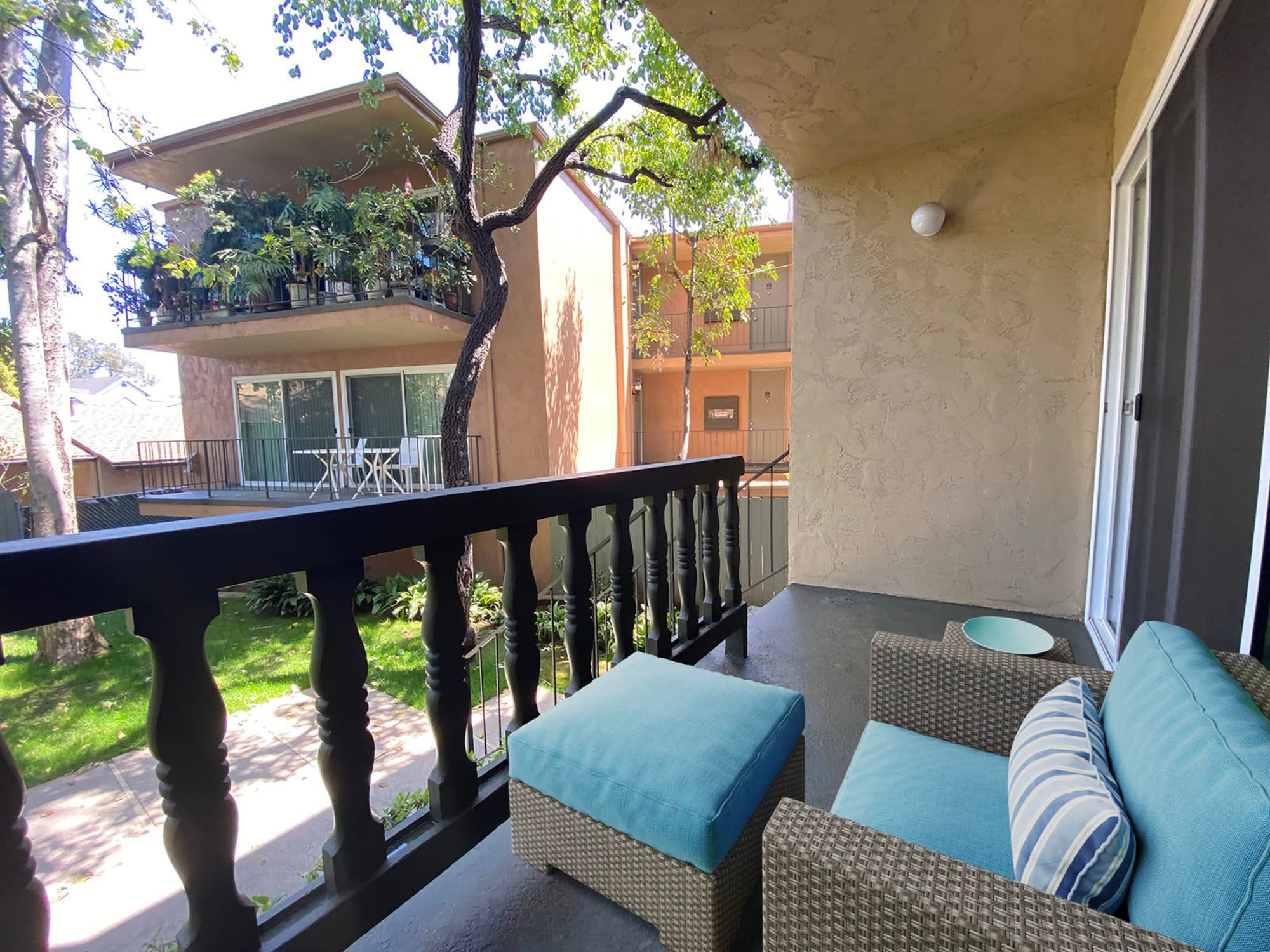 Well-furnished private balcony outside an apartment at Casa Granada in Los Angeles, California