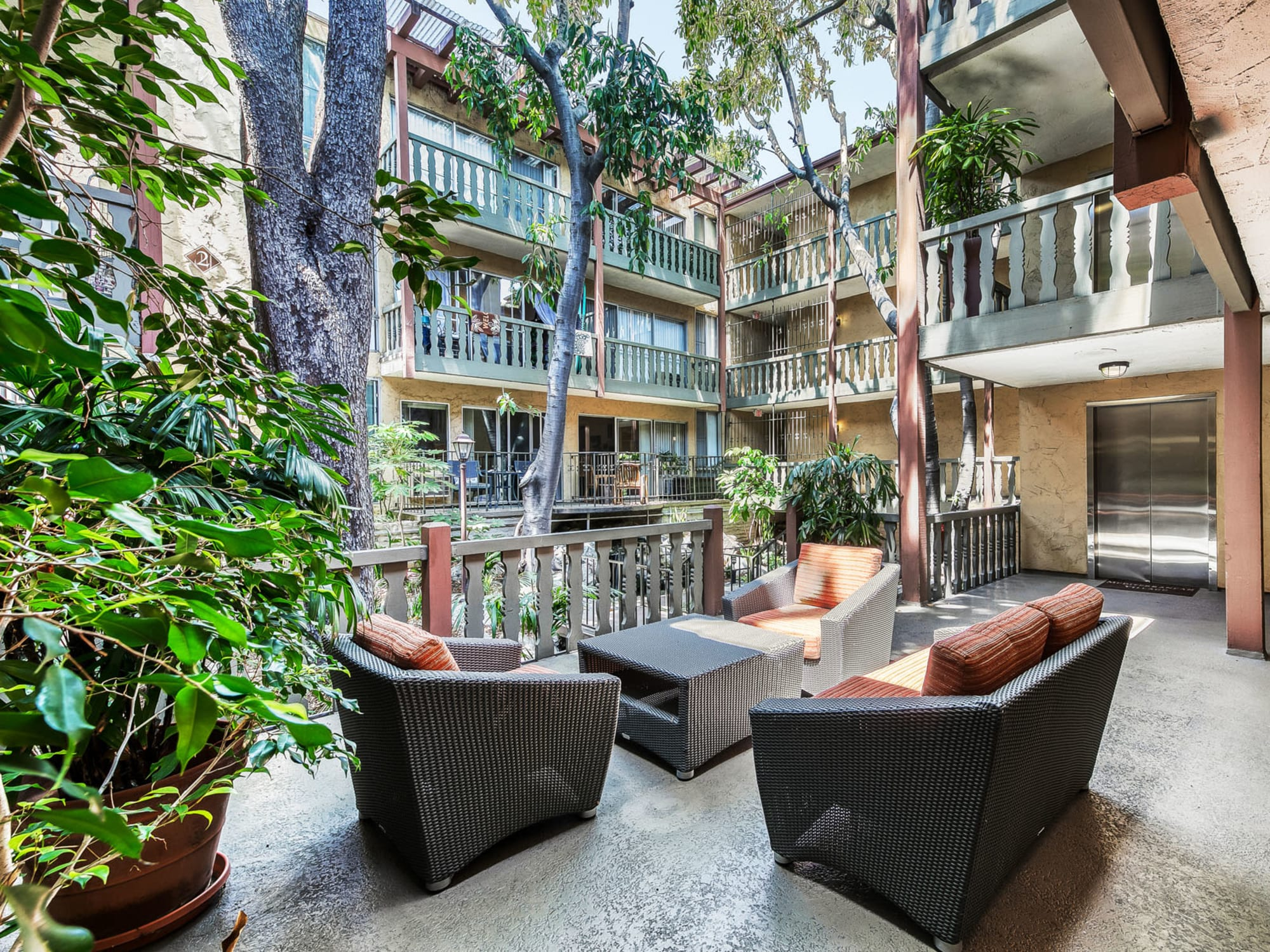 Lounge seating at one of the lush exterior courtyards at Mediterranean Village in West Hollywood, California