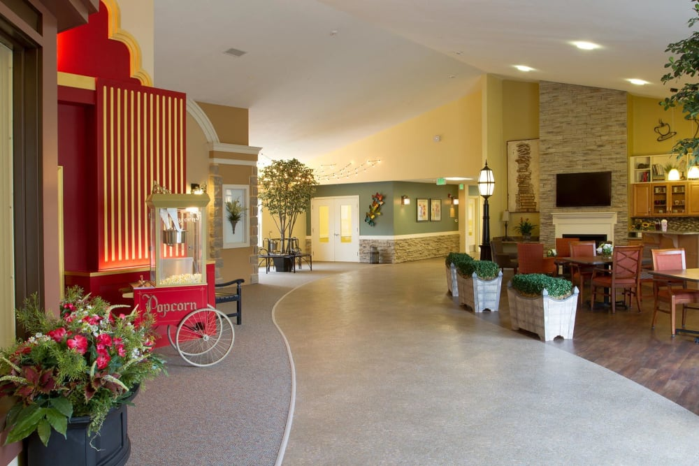 Common area leading to the cafe and theater at Randall Residence of Tipp City in Tipp City, Ohio