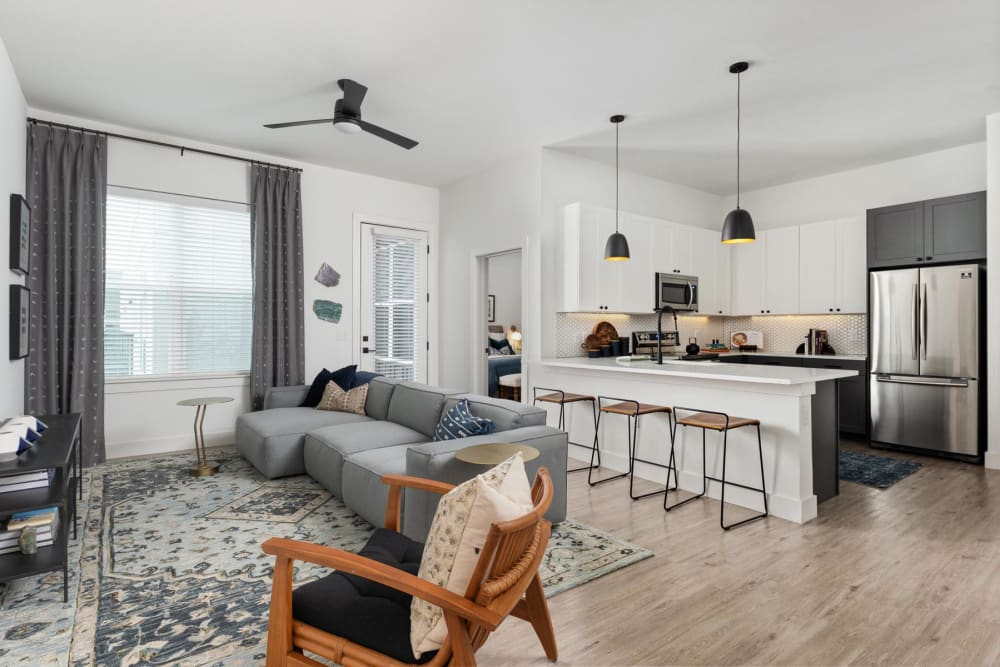 Spacious open-concept home's living space with a view of the kitchen over the breakfast bar at 4600 Ross in Dallas, Texas