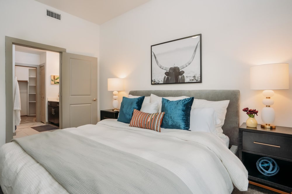 Well-furnished primary bedroom in a model home at Lakeshore Pearl in Austin, Texas