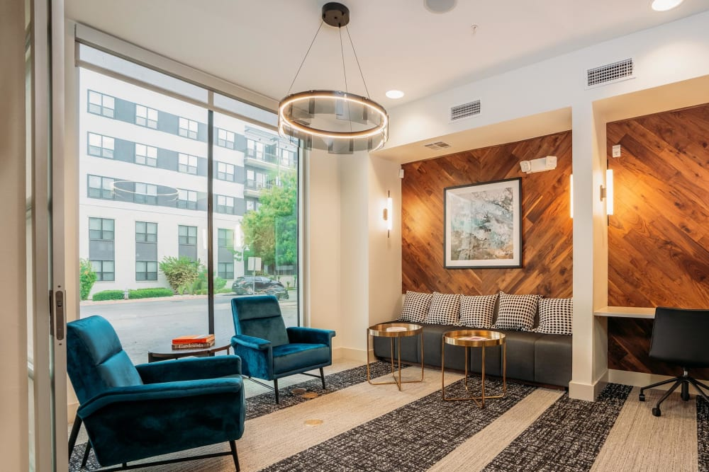 Modern furnishings and floor-to-ceiling windows in the lobby at Lakeshore Pearl in Austin, Texas
