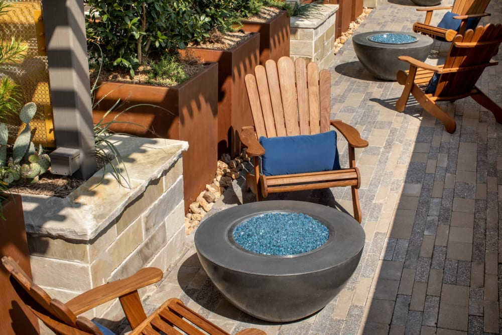Adirondack chairs around fire pits at Magnolia Heights in San Antonio, Texas