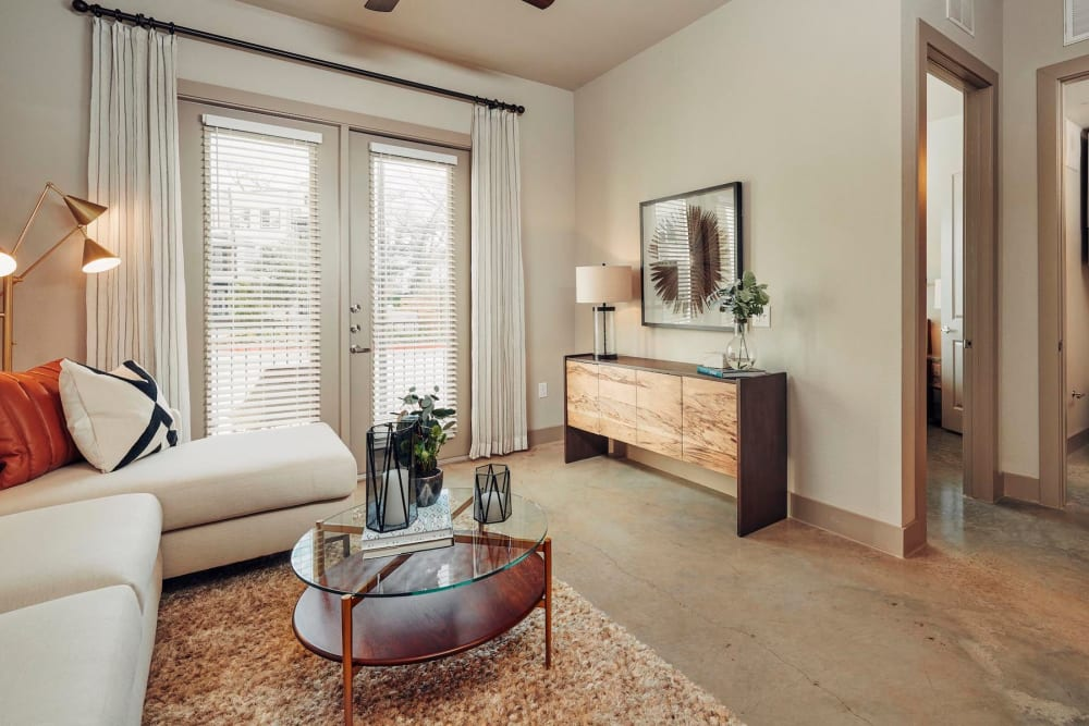 Modern furnishings in the living area of a model home at The Guthrie in Austin, Texas