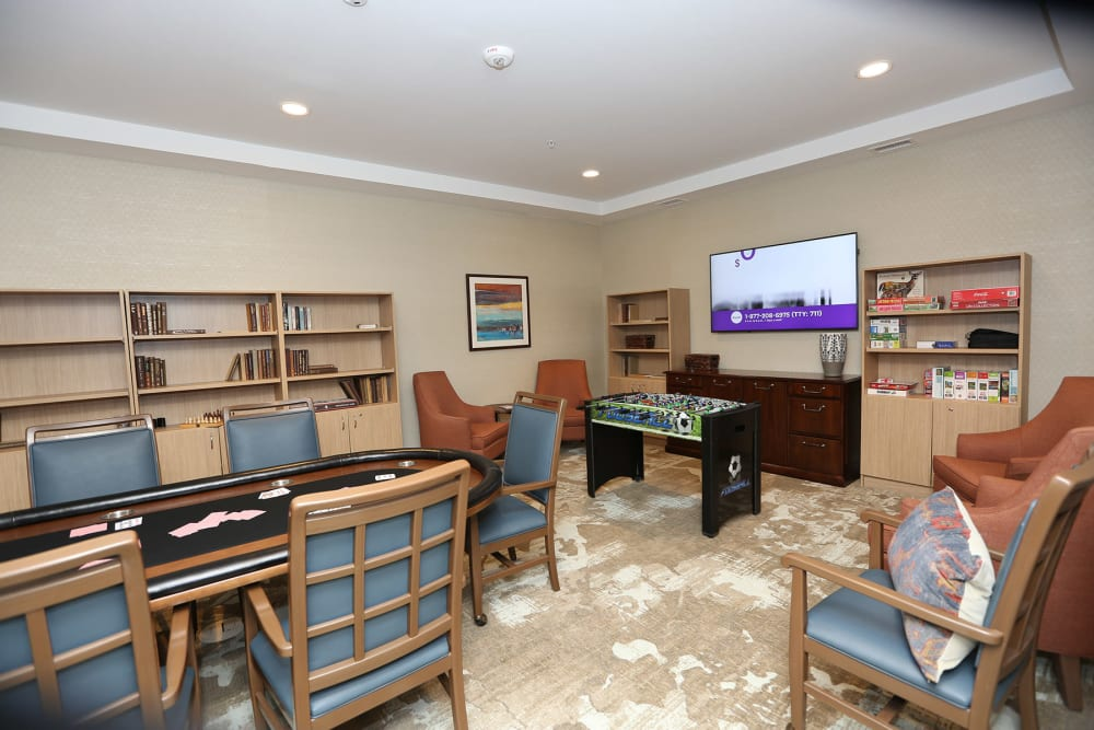 Activity room with a betting table and foosball at Quail Park at Morrison Ranch in Gilbert, Arizona