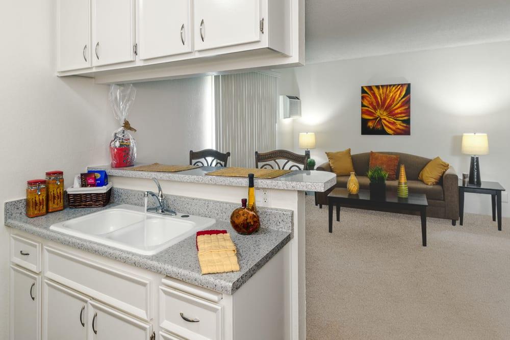 Kitchen and living room at The Newporter in Tarzana, California