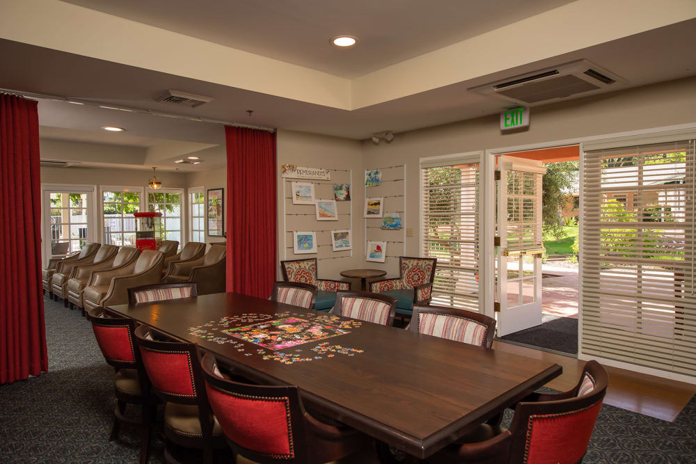 Lounge room with a jigsaw puzzle on the table at Gables of Ojai in Ojai, California