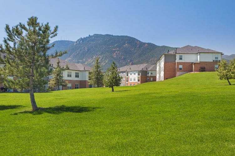 Exterior view of the apartments at Retreat at Cheyenne Mountain Apartments