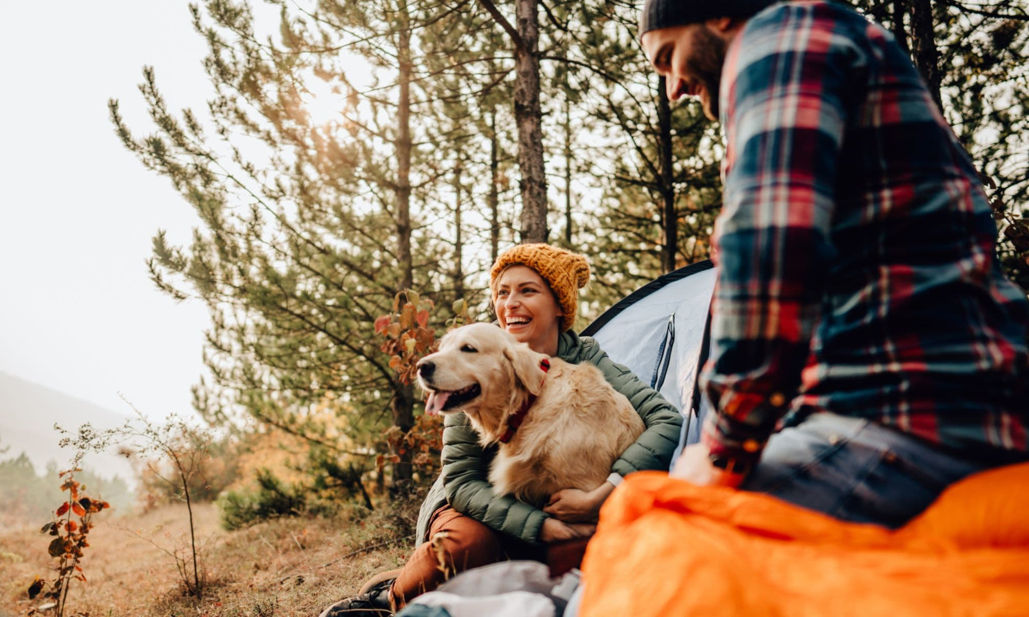Friends on a camping trip with their cute puppy dog near Liberty SKY in Salt Lake City, Utah