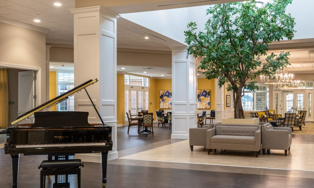 Main common area with a skylight and a piano at Randall Residence of Centerville in Centerville, Ohio