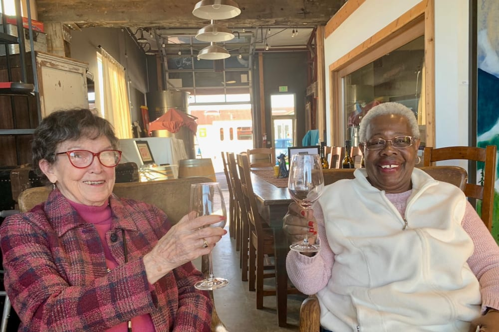 Two residents enjoying a happy hour near Merrill Gardens at First Hill in Seattle, Washington.