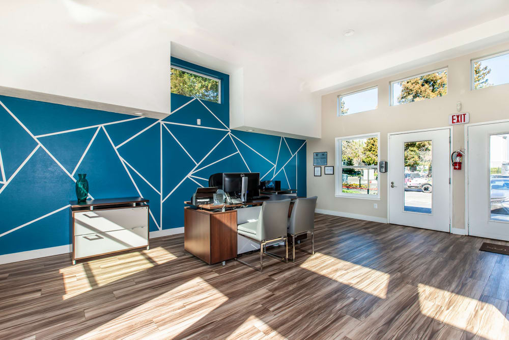 Inside of the sunlit clubhouse at Bennington Apartments in Fairfield, California